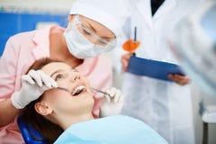 Checking up teeth Royalty Free Stock Photos