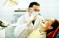 Checking up teeth Stock Photo