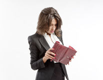 Checking the wallet. Young businesswoman dressed in office outfit checking her wallet Royalty Free Stock Images