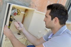 Checking the water meter. Appliance stock image