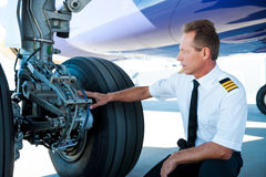 Checking the wheels. Royalty Free Stock Photography