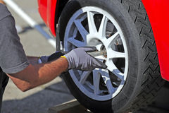 Checking wheels on a rallye car Stock Photography