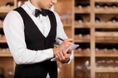 Checking wine list. Stock Photo