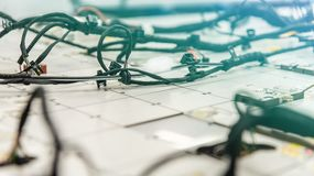 Checking the wiring systems on control desk, checkpoint, automotive industry, high-quality products. Light effect royalty free stock photos