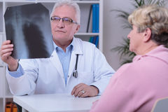 Checking the xray photo Royalty Free Stock Photography