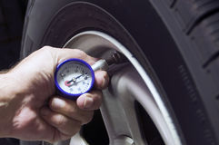 CheckingTire Pressure Royalty Free Stock Image