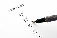Checklist. With three boxes ticked and a pen Stock Photo