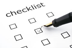Checklist. With one box ticked and a pen Stock Image