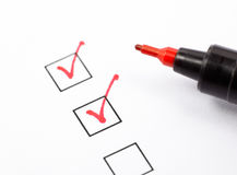 Checklist. Close up shot of filled check boxes with red pen Royalty Free Stock Photo