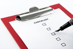 Checklist. And pen on clipboard, white background Royalty Free Stock Images
