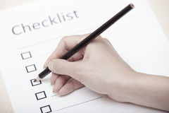 Checklist. Human hand writing on a checklist document Stock Photos