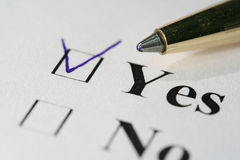 Checklist. The close-up of a pen and white checklist with a checkboxes with words YES and NO Royalty Free Stock Photography