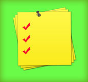 Checklist. Yellow adhesive note with completed checklist Royalty Free Stock Photography
