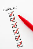 Checklist. With checkboxes ticked using red pen Stock Photos