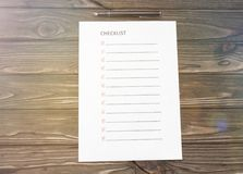 Checklist. black fountain pen on the background. Checklist. black pen on the background of a wooden table. business. planning. questionnaire stock photography