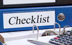 Checklist - blue binder with text. On desk in the office royalty free stock photography
