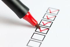 Checklist box. Checklist marked red with a red pen stock photo