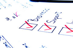 Checklist with business concepts. Checklist of things needed to start a business Stock Photo