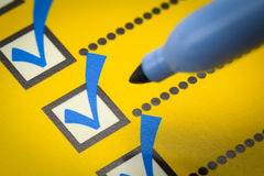 Checklist Closeup. Yellow Checklist with Blue Marker Close Up Royalty Free Stock Photo