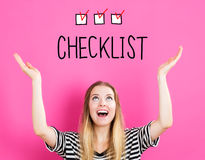 Checklist concept with young woman. Reaching and looking upwards Royalty Free Stock Photography