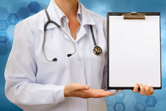 Checklist in hand doctor . royalty free stock photo