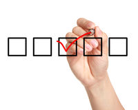 Checklist. Male hand checking the checklist boxes isolated with white background Royalty Free Stock Image