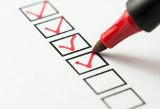 Checklist box marked with red pen. Checklist marked red with a red pen stock photo