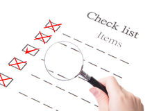 Checklist paper and magnifier glass close up Stock Image
