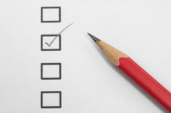 Checklist. On paper and red pencil royalty free stock photos