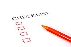 Checklist with pen. And checked boxes royalty free stock photo