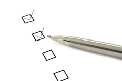 Checklist and pen. Checklist on white paper and silver pen Royalty Free Stock Images