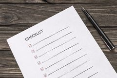 Checklist, pen on the background of a wooden table. Business. financial planning royalty free stock photo