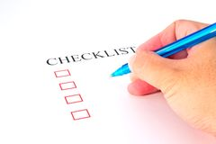 Checklist with pen and checked Stock Photo