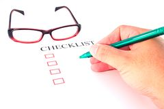 Checklist with pen, glasses Royalty Free Stock Image