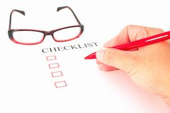 Checklist with pen, glasses and checked. Boxes stock photo