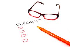 Checklist with pen, glasses and checked Stock Photos