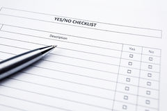 Checklist with a pen. Yes or no choice royalty free stock photography