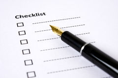 Checklist ready to be filled . . . A checklist with a fountain pen alongside. No Tick or Cross has been marked on options to which extend liberty to designer Royalty Free Stock Image