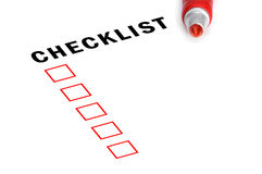 Checklist with red marker and checked boxes. Stock Photography