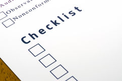 Checklist with a ticked box on white paper. Royalty Free Stock Photo