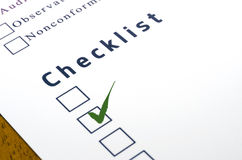 Checklist with a ticked box on white paper. Royalty Free Stock Images
