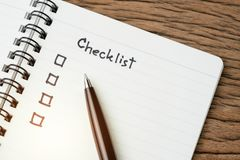 Checklist, to do list, prioritize or reminder for project plan, selective focus on pen with handwriting headline the word. Checklist and check box on small royalty free stock photo