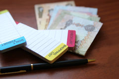 Checklist, to do list. With uae dirhams Royalty Free Stock Photo