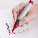 Checklist on white with marker and woman hand Stock Photography