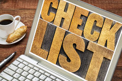 Checklist word typography on laptop Royalty Free Stock Photography