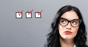 Checklist with young businesswoman stock photo