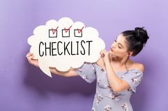 Checklist with woman holding a speech bubble. Checklist with young woman holding a speech bubble stock images