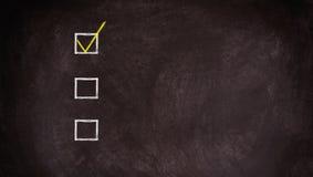 Checkliste an der Tafel mit Kopienraum Lizenzfreie Stockfotografie