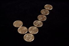 Checkmark Coins. A check mark made out of dollar coins Stock Photography