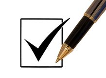 Checkmark and pen Royalty Free Stock Images